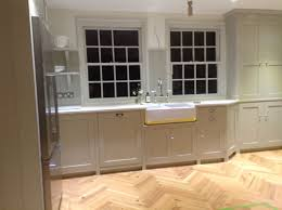 how to paint cabinets with farrow and farrow and drop cloth on the cabinets kitchen cabinet