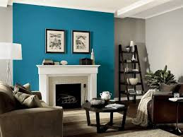 blue painting on one side wall as an accent white table lamp with
