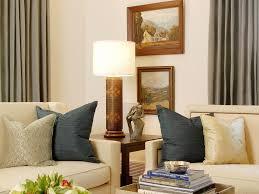 coffee table window treatment chair art curtain pillow lamp gold