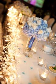 white roses and baby blue hydrangeas wedding flower bouquet