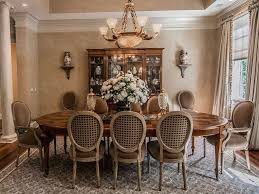 traditional dining room with wall sconce u0026 crown molding in