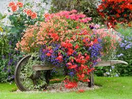 two men and a little farm flowers in a wheelbarrow inspiration