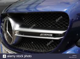 logo mercedes benz amg the front end of a blue mercedes benz c63s amg showing the grill