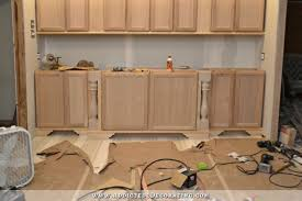 easy way to make own kitchen cabinets diy decorative feet for stock cabinets
