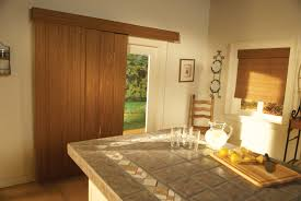 wide sliding glass door built in brown plywood veener windows