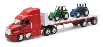 volvo semi truck models amazon com peterbilt truck with flatbed trailer and 2 farm