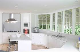white wooden kitchen island with cream marble counter top plus