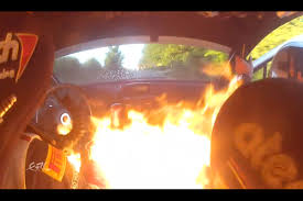 peugeot fire rally driver races on as car catches fire biser3a