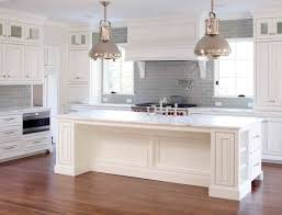 white kitchen with backsplash gray tile with white cabinets tile all the way up to ceiling mid
