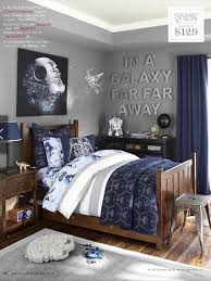 young boys bedroom using navy blue and grey with orange accents