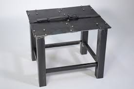 medieval inspired metal forged table is hugged by an iron belt