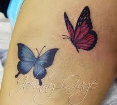 blue and pink flying butterflies on leg by johnny gage