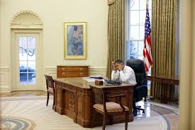 file barack obama working at his desk in the oval office jpg