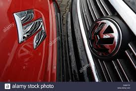 logo suzuki motor a car with a wolkswagen logo and a car with a suzuki logo stan