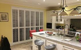 plantation home interiors plantation shutters with curtains benjamin baltic gray