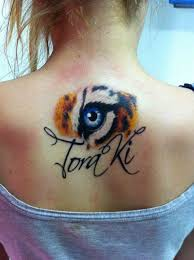 tiger eye tat im in love and will copy this minus the name