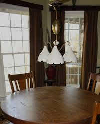 height to hang light over dining room table lighting over a