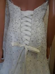 lace wedding dress with open back and beaded wedding sash