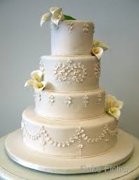 cake fiction piped ivory wedding cake with calla lilies