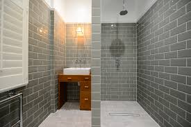 a perfect british period restoration grand design london grey tiles gray brathroom toiler trinity road grand design london bespoke tiles sink lamp bath tub