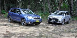 blue subaru forester 2015 mitsubishi outlander v subaru forester suv comparison review