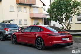 porsche panamera modified porsche panamera turbo s e hybrid in deep red looks a stunner