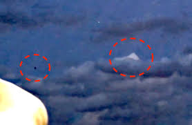 Ufo sightings daily black ufo near white pyramid cloud over
