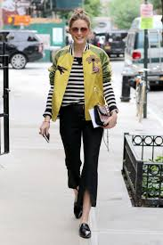 olivia palermo pairs a yellow bomber jacket with black and white