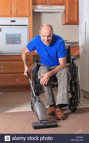 man with friedreich u0027s ataxia and deformed hands vacuuming his