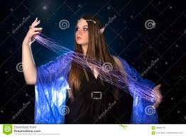 young female elf princess playing with magic at night stock photo