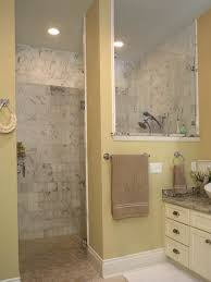 brown stone wall with black corner shelves plus silver shower