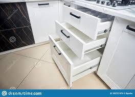 horizontal kitchen storage cabinets solution for placing kitchen utensils in modern kitchen
