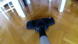 vacuum cleaner hoovering wooden floor and carpet stock footage
