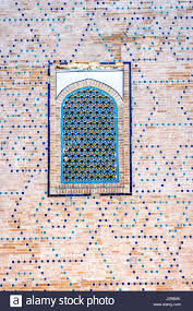 window on a wall of blue tiles and mosaic of registan mausoleum