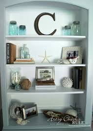 how to decorate a bookshelf coastal styled bookshelves how to style shelves artsy chicks rule