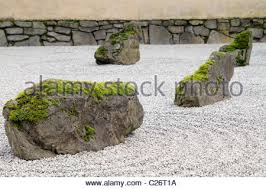 stone and sand garden at portland japanese garden with tiled roof