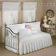 dark brown ornate wrought iron bed design come with classic style