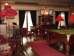the billiard room with the mahogany billiard table and beautifully