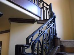 custom ornamental stair railing in texture bronze finish by