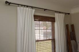 room divider rod living room curtain rod b before the chaseys