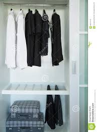 Clothes Hang On A Shelf In A Designer Clothes Store Modern Closet