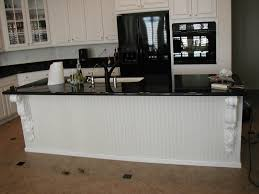 white kitchen cabinets with stainless steel appliances u2014 smith