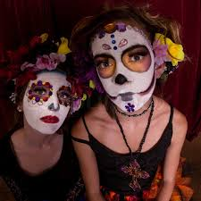 dia de los muertos costumes dressed in day of the dead costumes and colorful make up
