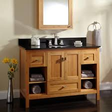 wood bathroom vanity with storage have black marble countertop