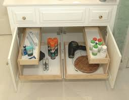 white wooden bathroom cabinet with pull out sliding shelves and