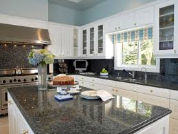 kitchens with white cabinets and dark granite countertops