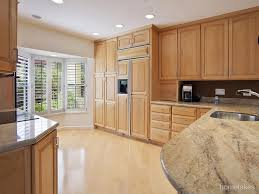 traditional kitchen with complex granite by alexander henry