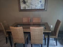 Wicker Dining Room Chairs Indoor Two Tones Wicker Dining Doom Set Under Framed Wall Art Elegant