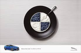 bmw ads jaguar devours bmw mercedes and audi in latest print ads via