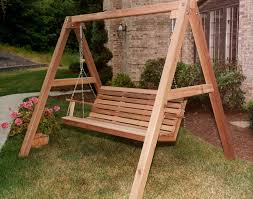 natural stained wood porch swing with stand in triangle shape